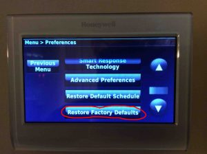 Picture of the Menu, Preferences, Restore Factory Defaults button circled.
