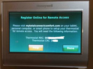 Picture of the Honeywell RTH9580WF smart t-stat, showing the Register Online for Remote Access screen.