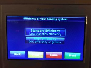 Picture of the Honeywell RTH9580WF WiFi Smart Thermostat, displaying the Efficiency Of Your Heating System screen.
