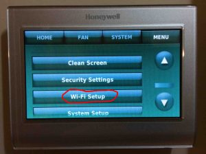 Picture of the Honeywell RTH9580WF WiFi smart t-stat menu, with the WiFi Setup button circled. Reconnecting Honeywell thermostat RTH9580WF to WiFi network,