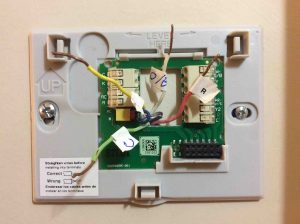 Picture of the Honeywell Smart Thermostat RTH9580WF wall plate, mounted, but with wires not yet connected.
