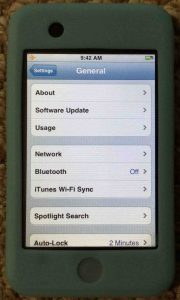 Picture of the Apple iPod Touch portable media player, displaying the General Settings screen.