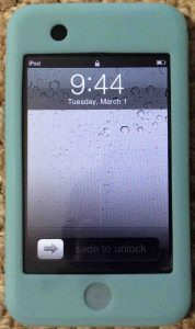 Picture of the iPod Touch portable player, displaying the Lock screen.