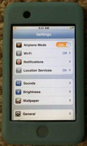 Picture of the Apple iPod Touch portable media player, displaying the Settings menu.