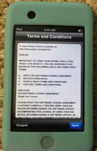Picture of the Apple iPod Touch portable player, displaying the Terms and Conditions screen.