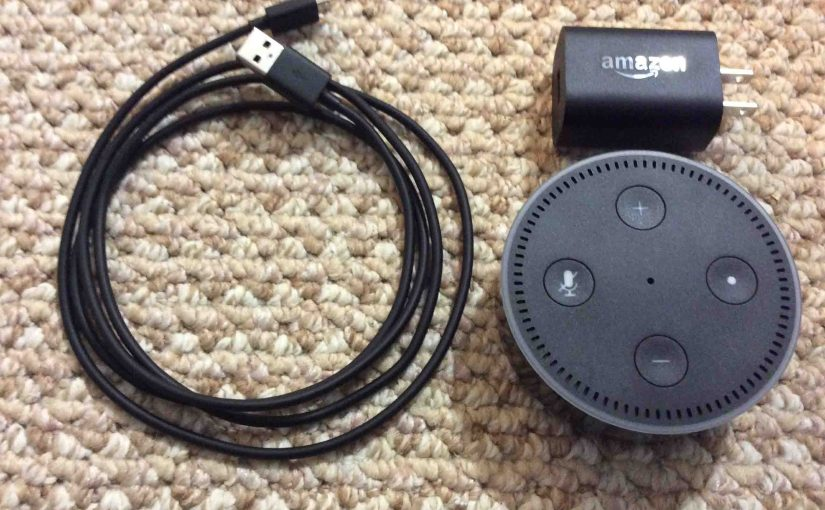 Picture of the Amazon Alexa Dot 2nd Gen with adapter and USB cable.
