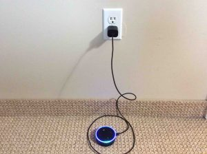 Picture of the unboxed Amazon Echo Dot 2nd Gen Speaker, plugged in and booting. Powering up.