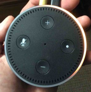 Picture of the Alexa Echo Dot Gen 2 in Setup Mode, after factory reset, showing Light Ring with orange blip circling.