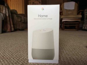 Picture of the Google Home, showing the front of the original packaging, closed, not yet opened.