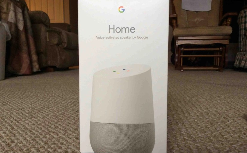 Picture of the Google Home Voice Activated Speaker, showing the front of the original packaging, closed, not yet opened.
