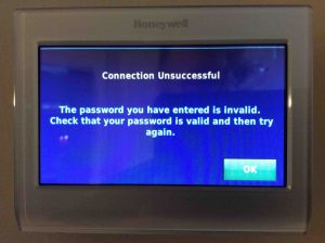 Picture of the Honeywell RTH9580WF Smart Thermostat, displaying the Connection Unsuccessful screen, due to an incorrect network password.