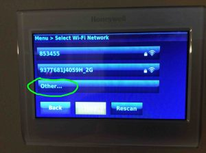 Picture of the RTH9580WF t-stat, displaying the -Select WiFi Network- screen, with the Other... option highlighted.