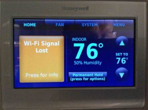 Picture of a Honeywell t-stat, displaying its -Lost Wi-Fi Signal- message.