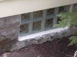 Picture of the exterior side of the Basement glass block window replacement 7, with the shims removed, and installation complete.