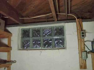 How to install glass block windows. Picture of the binside view of the asement glass block window replacement 7, mortar applied and shims removed, installation done.
