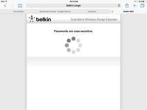 Picture of the Belkin F9K1122v1 Wi-Fi range extender in setup mode, displaying the -Checking Wireless Network Password- screen.
