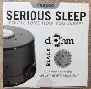 Picture of the Marpac Serious Sleep SS white noise machine, black version, original box top.