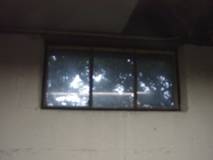 How to install glass block windows. Picture of an old metal framed basement window 1 prior to replacement.