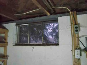 Picture of the old, literally crumbling basement window 7, prior to replacement.