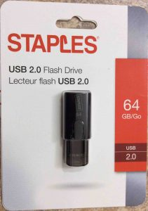 Picture of the Staples USB 2.0 stick drive, 64 GB, front view of original package.
