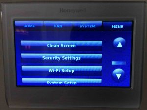 Picture of the Honeywell RTH9580WF smart thermostat, displaying the unlocked form of its -Main Menu- screen, scrolled down to show unlocked options.