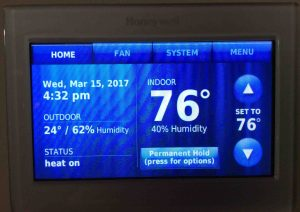 Picture of the Honeywell RTH9580WF thermostat, displaying its -Home- screen, after new temperature offset applied.