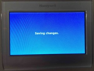 Picture of the Honeywell RTH9580WF thermostat, showing its -Saving Changes- screen.