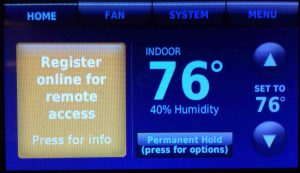 Picture of the Honeywell RTH9580WF Wi-Fi thermostat, displaying the -Register Thermostat Online- message.