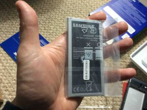Picture of the phone's battery, showing the label side. Unboxing Samsung Galaxy J7.