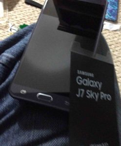Picture of the Samsung Galaxy J7 Sky Pro smart phone, front view, with screen protector removed.