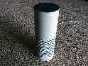Picture of the Amazon Echo Gen 1 smart speaker, front view. Echo Spotify commands.
