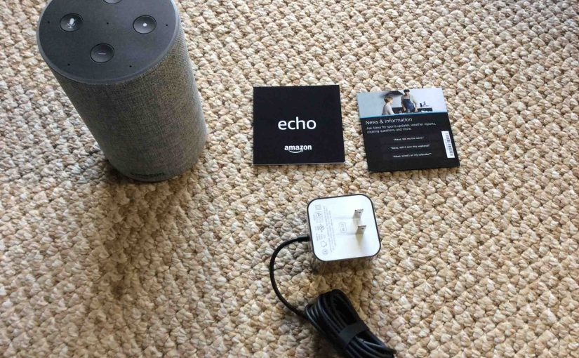 Picture of the Amazon second generation echo speaker with sll accompanying accessories unboxed.