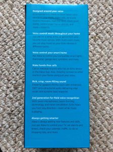 Picture of the Amazon Echo 2nd generation voice activated speaker box, side view, showing main features list .