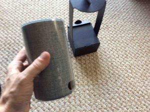 Picture of the Amazon Echo 2nd gen voice activated speaker, removed from cardboard holder packaging.