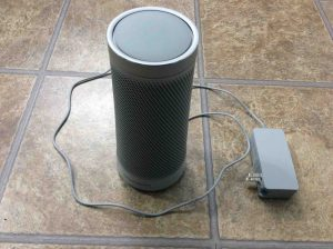 Picture of the Harman Kardon Invoke Cortana smart speaker, with its AC adapter unplugged from wall and powered off.