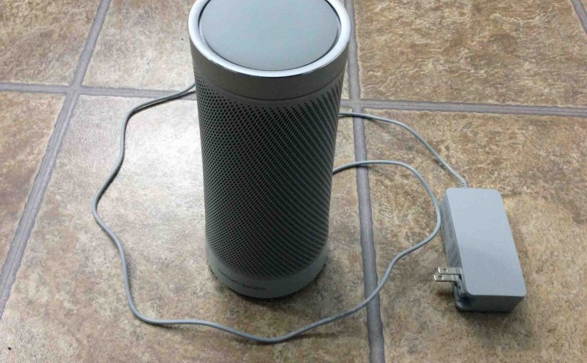 Picture of the Microsoft Invoke Cortana smart speaker, with its AC adapter unplugged from wall and powered off, prior to rebooting.
