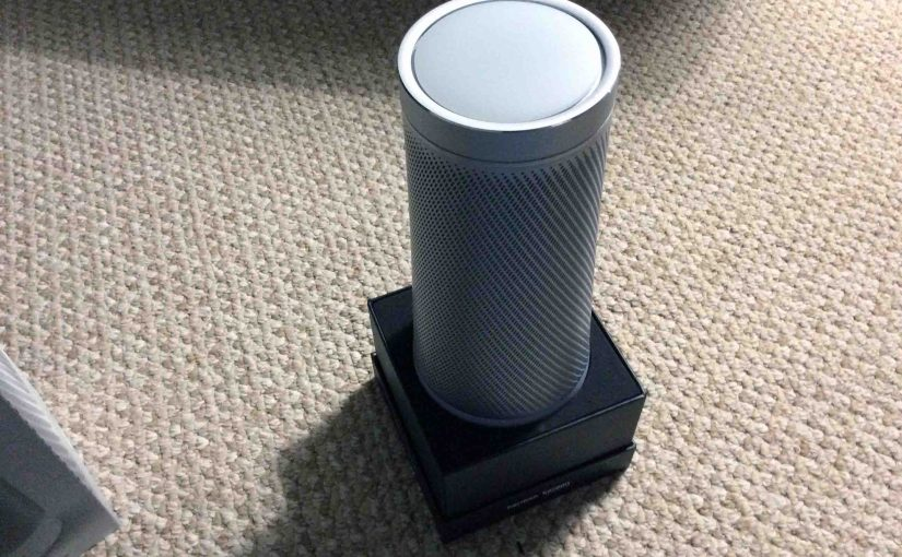 Picture of the Microsoft Invoke voice activated speaker, new in box, with the top outer shell removed.