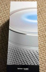 Picture of the Harman Kardon Invoke speaker, side view, new in box, outer plastic removed.