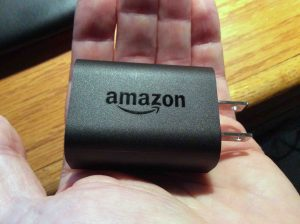 Picture of the USB AC power adapter for the Amazon Alexa Echo Dot Gen 2 smart speaker, logo side.