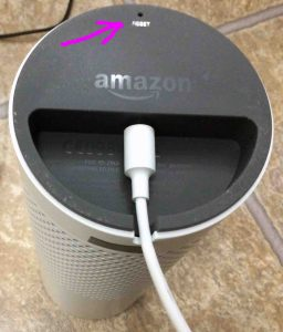 Picture of the Amazon Echo Generation 1 smart speaker bottom view, showing the reset button location Highlighted.