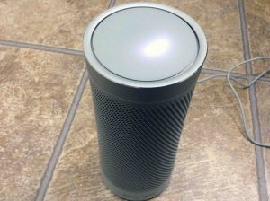 Picture of the Harman Kardon Invoke Cortana smart speaker, reboot in progress.