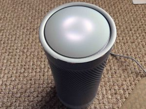 Picture of the Harman Kardon Invoke voice activated Cortana smart speaker, front top view, showing lights displaying Ready for Setup status.