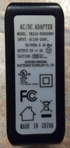 Picture of the AC Wall Adapter for the Victor Reader Trek Navigator by Shenzhen Simsukian Electronics, Showing its Label Side with Specifications.