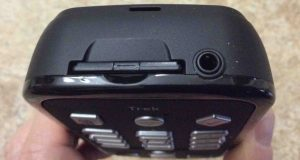 Picture of the HumanWare Victor Reader Trek talking book player and GPS navigator, top view, showing the SD card slot and headphone / external microphone port.