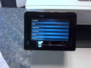 Picture of the Color Laserjet Pro M477 printer, displaying its -Location Selection- screen.