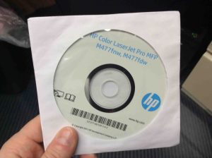 Picture of the HP Color Laserjet M477 driver software disc.