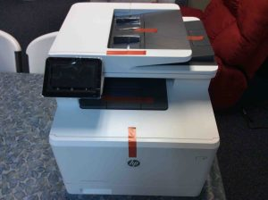 Picture of the HP color Laserjet pro M477 printer, unboxed, front view.