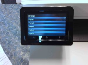 Picture of the HP Color M477 printer, displaying its -Language Selection- screen.