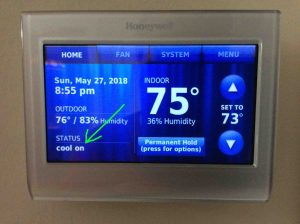 Picture of the RTH9580WF WiFi thermostat, showing its -Cool On- message highlighted after the Honeywell thermostat Waiting for Equipment message disappeared.