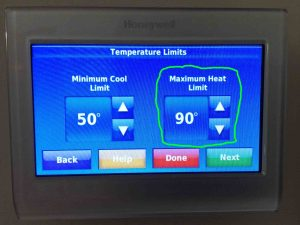 Picture of the Honeywell RTH9580WF WiFi thermostat, showing its -Temperature Limits- screen, with the -Maximum Heat Limit- adjustment highlighted.